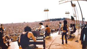 Guitarist Carlos Santana performs at the Woodstock music festival in Bethel, New York, in 1969.(Photo: Woodstock/ Twitter)