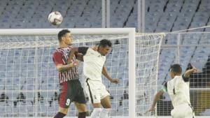 Salvador Perez Martinez (9) of Mohun Bagan and Sujit Sadhu (4) of Mohammedan Sporting Club in action.(Samir Jana/HT Photo)