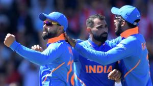 File image of Virat Kohli celebrating the fall of a wicket with Mohammed Shami and KL Rahul (L-R).(AFP)