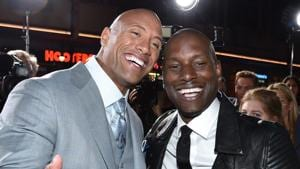 Dwayne Johnson, left, and Tyrese Gibson arrive at the premiere of Fast & Furious 7 in Los Angeles.(AP)