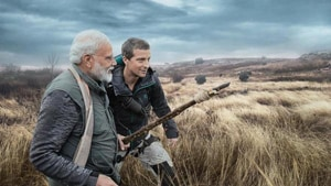 """What stood out the most about Modi throughout the journey, Grylls said, was the global leader's humility, as even through incessant rains, there was a """"big smile"""" on his face.(Discovery channel image)"""