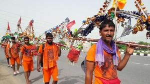 Kanwad Yatra is in full swing nowadays .Devotees of Shiv from Jhunjhnu (Rajsthan) with Kanwad are passing through Rohtak Photo by Manoj Dhaka/HindustanTimes