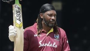 West Indies opener Chris Gayle raises his bat to the crowd after reaching a half century in third ODI against India.(AP)