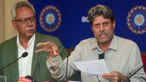 Former India captain and Chairman of Cricket Advisory Committee Kapil Dev interacts with media, as Anshuman Gaekwad, member Cricket Advisory Committee, looks on. Incumbent Ravi Shastri today, was re-appointed head coach of the Indian men's team.(PTI)