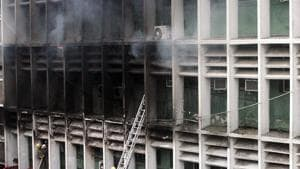 A senior police officer present on the spot said the fire was limited to three-four rooms on the fifth floor.(ANI Photo)