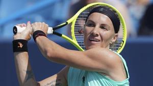 Svetlana Kuznetsova, of Russia, returns to Ashleigh Barty, of Australia.(AP)