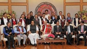 A file picture shows Prime Minister Narendra Modi and Union home minister Rajnath Singh with Naga leaders after signing the framework agreement in 2015. Seated on the extreme right is R N Ravi, chief interlocutor and Prime Minister Narendra Modi's envoy, who is leading the Centre's team of interlocutors.(PTI File Photo)