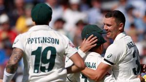 Australia's Josh Hazlewood celebrates with teammates after taking the wicket of England's Jos Buttler.(Action Images via Reuters)