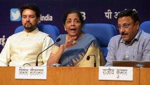 Finance Minister Nirmala Sitharaman with her MoS Anurag Thakur (L) and Finance Secretary Rajiv Kumar addresses a press conference announcing a slew of economic measures to boost growth, at National Media Centre in New Delhi, India, on Friday, August 23, 2019.(Mohd Zakir/HT PHOTO)
