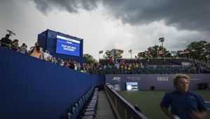 Fans leave the stands as a storm rolls in and play has been suspended in a match between Pablo Carreño Busta, of Spain, and Benoit Paire, of France, at the Winston-Salem Open tennis tournament Thursday, Aug. 22, 2019, in Winston-Salem, N.C.(AP)