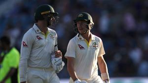 Australia's Marnus Labuschagne and James Pattinson leave the pitch at the end of play on day two.(Action Images via Reuters)