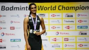 India's Pusarla Sindhu celebrates on the podium with her gold medal after winning the women's singles final in the BWF World Championships in Basel.(REUTERS)