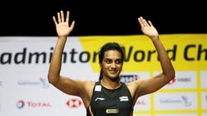 Sindhu celebrates on the podium after winning the women's singles final.(REUTERS)