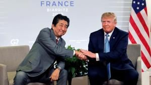 US President Donald Trump and Japan's Prime Minister Shinzo Abe shake hands as they attend a bilateral meeting during the G7 summit in Biarritz, France.(Reuters photo)