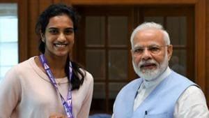 PM Modi with PV Sindhu.(PM Modi/ Twitter)