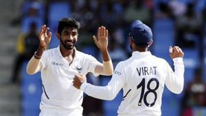India's Jasprit Bumrah celebrates with team captain Virat Kohli(AP)