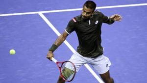 Sumit Nagal rushes the net as he returns to Roger Federer.(AP)
