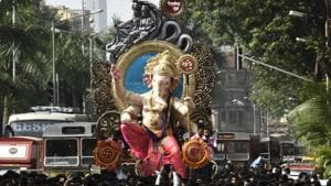 Two died of electrocution while carrying a 26-feet-tall Ganesha idol in Gujrat.(Kunal Patil/HT Photo)