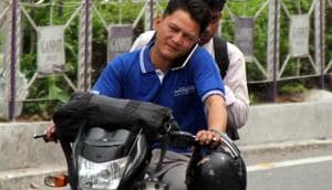 Government officials in Jharkhand will not be allowed to enter their offices if found riding two-wheelers without a helmet under a new 'no helmet, no entry' initiative of the state's transport department.(HT Photo)