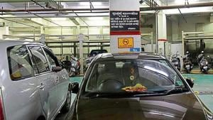 Despite the board suggesting otherwise, vehicles are being blatantly parked at this lot at Star Mall in Dadar, which is yet to be opened officially.(Kunal Patil/HT Photo)