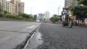 The police said the duo, who were not wearing helmets, had fallen down after the scooter rider skid on a road that was wet due to heavy rain.(Praful Gangurde/HT File Photo)