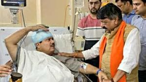 BJP National general secretary Kailash Vijayvargiya meets BJP Lok Sabha lawmaker from West Bengal's Barrackpore Arjun Singh who was injured during a protest against the Trinamool Congress in North 24 Parganas on Sunday.(ANI photo)