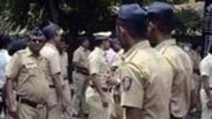 A police head constable was allegedly assaulted by four men, who also tried to snatch his weapon, after he stopped their car at a traffic post in Delhi in the early hours of Sunday(HT Photo)