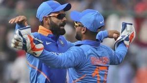 Indian cricket captain Virat Kohli, left, celebrates with teammate Rishabh Pant.(AP)