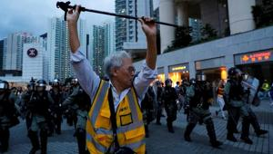 A man tries to block the riot police outside a metro station, in Hong Kong, China(REUTERS)