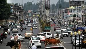 Vehicles ply after restrictions were eased in Srinagar on Saturday.(ANI photo)