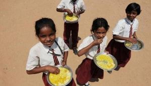 Students having midday meals at a government middle school.(HT FILE PHOTO)