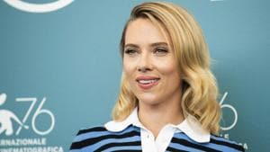 """Scarlett Johansson said in a fresh interview that she's standing by Woody Allen. """"I love Woody,"""" Johansson told The Hollywood Reporter.(Arthur Mola/Invision/AP)"""