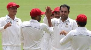 Mohammad Nabi celebrates with his teammates after the fall of a wicket.(ICC/ Twitter)