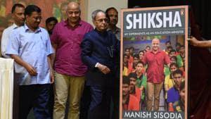 Delhi Chief Minister Arvind Kejriwal, Deputy Chief Minister Manish Sisodia and former President Pranab Mukherjee during the release of Sisodia's book 'Shiksha,' at NDMC Convention Centre, in New Delhi, India, on Thursday(Raj K Raj/HT PHOTO)