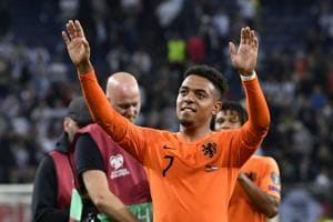 Netherlands' Donyell Malen waves to the supporters at the end of the Euro 2020 group C qualifying soccer match between Germany and the Netherlands at the Volksparkstadion in Hamburg, Germany, Friday, Sept. 6, 2019. The Netherlands won 4-2.(AP)