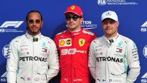 Ferrari's Charles Leclerc poses as he celebrates qualifying in pole position alongside second placed Mercedes' Lewis Hamilton and third placed Mercedes' Valtteri Bottas.(REUTERS)