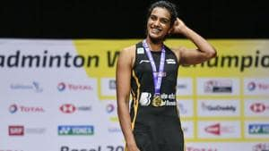 PV Sindhu poses on with the gold medal.(AFP)