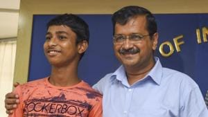 New Delhi: Delhi Chief Minister Arvind Kejriwal and Vijay Kumar, son of a tailor and a homemaker who cracked the IIT entrance examination, pose for a photograph during a press conference, in New Delhi, Sunday, Sep 08, 2019. (PTI Photo/Atul Yadav)(PTI9_8_2019_000043B)(PTI)
