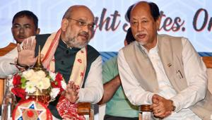 Union Home Minister Amit Shah and Nagaland Chief Minister Neiphiu Rio during the 4th Conclave of the North East Democratic Alliance (NEDA), in Guwahati on Monday.(PTI PHOTO.)