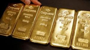 Gold prices are up about 18%, or over $200, since hitting year's low of $1,265.85 in May.(Reuters photo)