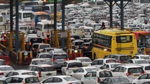 Commercial vehicles with radio frequency identification (RFID) tags are mandated to switch to cashless payments from Saturday, and several commercial vehicles drivers on Friday reached the toll plaza to make enquiries about recharges.(Yogendra Kumar/ HT PHOTO)
