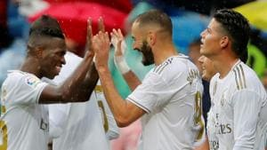Real Madrid's Karim Benzema celebrates scoring their second goal with Vinicius Junior and James Rodriguez.(REUTERS)