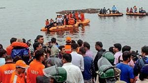 NDRF personnel rescue survivors from the swollen Godavari river in East Godavari district of Andhra Pradesh on Sunday afternoon.(PTI PHOTO.)