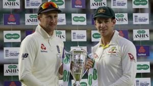England's Joe Root, left, and Australia's Tim Paine hold the trophy during the presentation ceremony(AP)