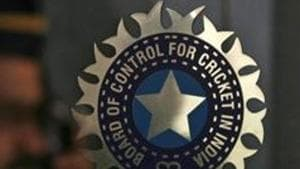A policeman walks past a logo of the Board of Control for Cricket in India (BCCI).(REUTERS)