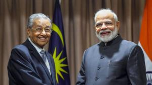 Prime Minister Narendra Modi with Malaysian counterpart Dr. Mahathir Mohamad.(PTI Photo)