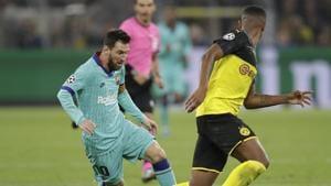 Messi returns as Dortmund rue missed chances against Barcelona