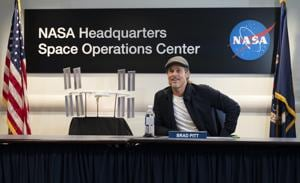 Brad Pitt speaks with NASA astronaut Nick Hague who is on board the International Space Station.(AFP)