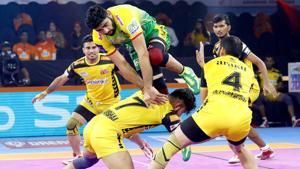 Pardeep Narwal tries to go for a raid against Telugu Titans.(PKL)