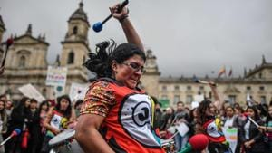 Musicians perform during a climate protest at Bolivar square in Bogota, Colombia, on September 20, 2019(AFP)